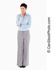 Thoughtful businesswoman standing up