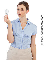Thoughtful businesswoman with light bulb