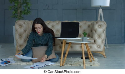 Thoughtful businesswoman working in home office