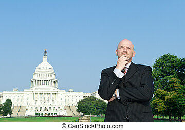 Thoughtful Caucasian Man Suit Standing US Capitol