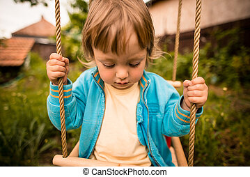 Thoughtful child on seesaw