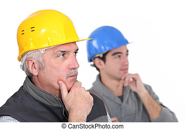 Thoughtful construction workers