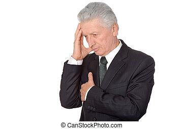 Thoughtful elderly man in suit
