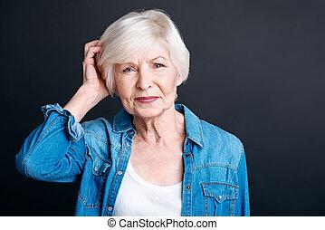 Thoughtful elderly woman feeling confused.