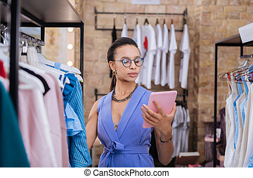 Thoughtful female sale assistant organizing sales presentation