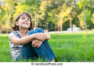 Thoughtful girl dreaming in the park