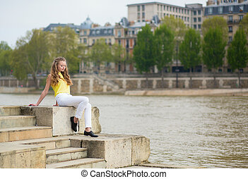 Thoughtful girl on the Seine embankment