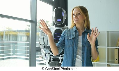 Thoughtful girl taking about office with robotic machine