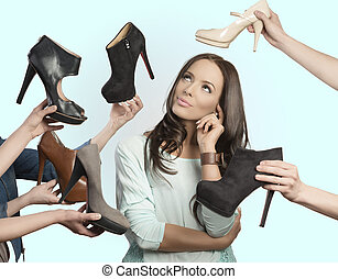 thoughtful girl with assortment of shoes