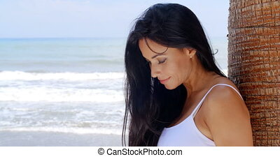 Thoughtful Lady Leaning Against Beach Palm Tree