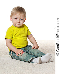Thoughtful little boy on the carpet
