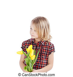 Thoughtful little girl with tulips