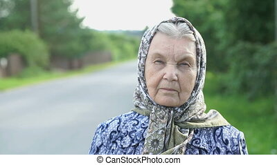 Thoughtful look of a serious old woman. Close-up -...