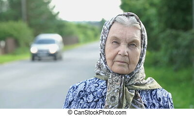 Thoughtful look of a serious old woman. Close-up