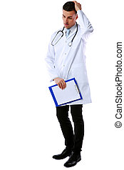 Thoughtful male doctor with clipboard and stethoscope standing over a white background