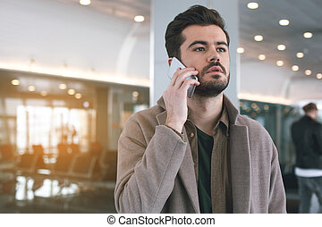 Thoughtful male speaking by phone