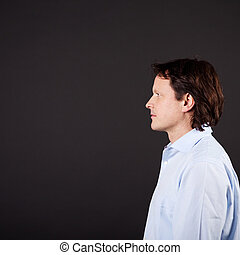 profile view of a mature, thoughtful man