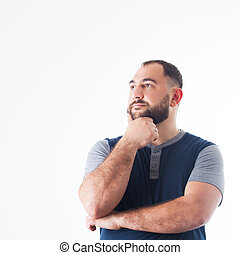 Thoughtful man looking aside isolated over white background