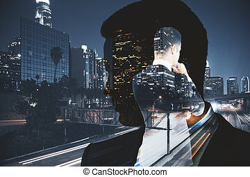 Thoughtful man on city background