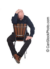 thoughtful man sitting on a chair