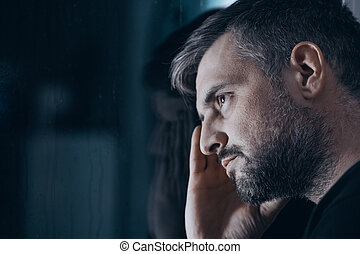 Thoughtful man with withdrawal symptoms - Close-up of...