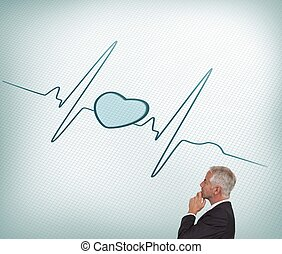 Thoughtful mature businessman looking at ecg line -...