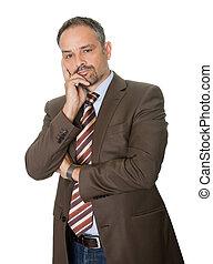 Thoughtful mature businessman on white background -...