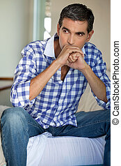 Thoughtful middle aged man looking away