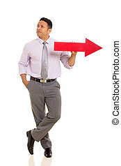 middle aged man with red direction arrow
