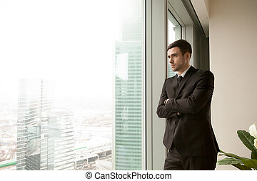 Thoughtful millennial CEO dreaming of success