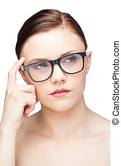Thoughtful natural model wearing classy glasses on white...