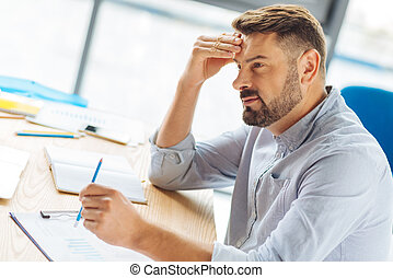 Thoughtful office worker sitting in semi position