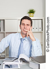 Thoughtful pensive businessman at his desk