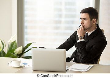Thoughtful pensive businessman deep in thoughts looking away at