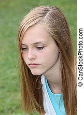 Thoughtful sad teenage girl