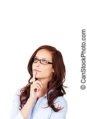 Thoughtful scholarly young woman wearing glasses with her...