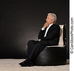 Thoughtful senior businessman