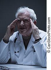 Thoughtful senior practitioner
