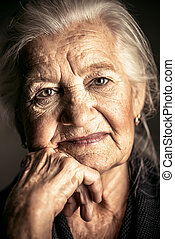 thoughtful senior woman - Portrait of a beautiful smiling...
