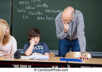 Thoughtful teacher in class