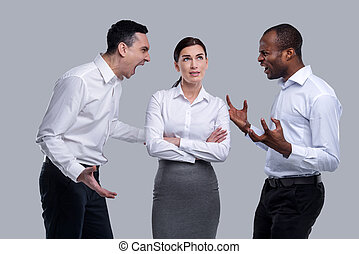 Thoughtful woman and angry men shouting at each other
