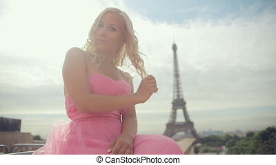 Thoughtful woman dressed in festive pink strapless dress...