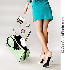 Thoughtful woman dropping a handbag