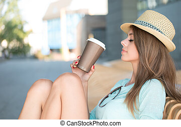 Thoughtful Woman Holding a Cup of Coffee
