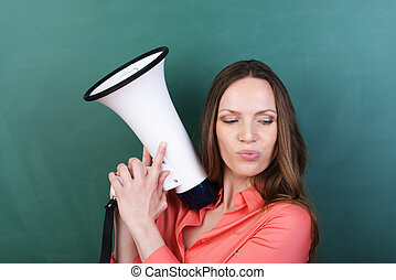 Thoughtful woman holding a megaphone