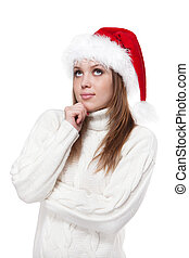 Thoughtful woman in a Santa hat isolated on white background
