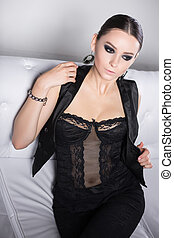 ?Thoughtful woman in black lingerie