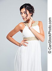 Thoughtful woman in fashion dress looking away