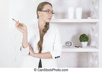 Thoughtful woman in office