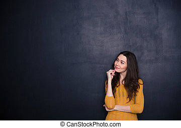 Thoughtful woman looking away at copyspace - Portrait of a...